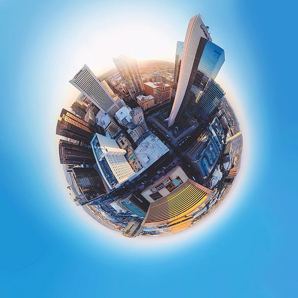 View of a city in a circle surrounded by blue background.
